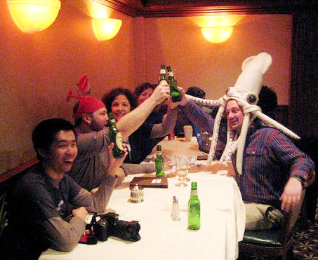 Andrew (squid hat) and I (crab hat) toasting to sea shanties with blog peeps at Science Online 09. Photo by Danica.