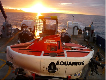 Aquarius and two DeepWorkers on the back deck of RV Cape Flattery in the British Columbia sunset