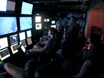 In the ROV control room.  You can see Chris there on the right with his left hand on his chin. I am in the background about dead center (the bald one with the headset on doing my cheif scientist thing.