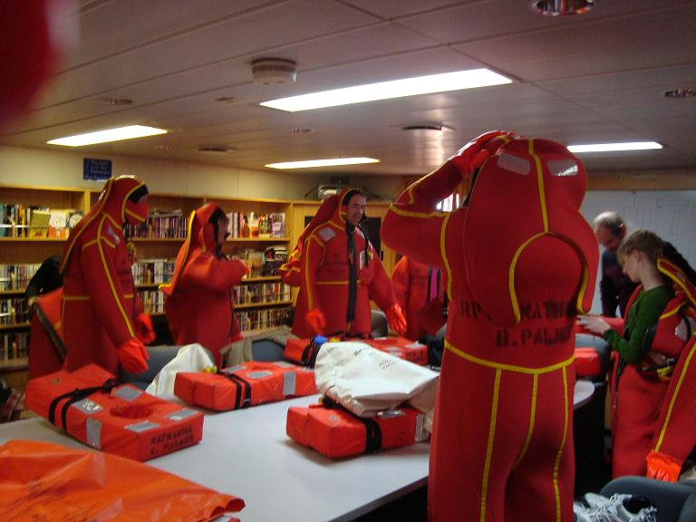 Trying on survival suits at our safety meeting.