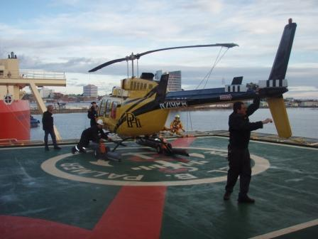 Helicopters on loan from the Argentine Antarctic Program arrive on board the Palmer during port call.