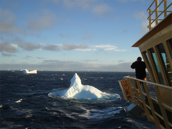 Dr. Martin Truffer photographs an iceberg in the tumultuous Bransfield Strait.