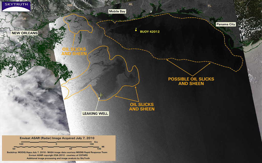 This satellite radar image taken by Envisat's ASAR sensor at 10:44pm local time on July 7 shows a large patch of oil extending north from the site of the leaking Macondo well, and an area of small slicks along the Mississippi shoreline.   A large dark area extending from Mobile Bay to beyond Panama City may include patchy oil slicks and sheen, as seen in this area on previous days. But it is also an area of calm winds; the surface wind speed was measured at Buoy 42012 at 1 meter per second, gusting to 2 m/s, at the time this image was acquired. That's on the low-end threshold for oil slick detection with radar imagery.