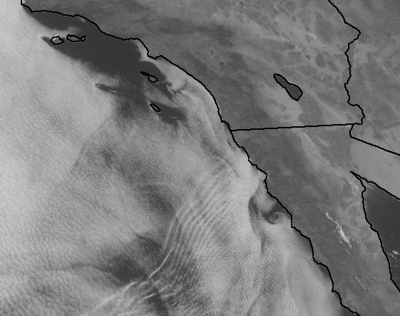 Wave patterns visible in clouds off Baja California Sur