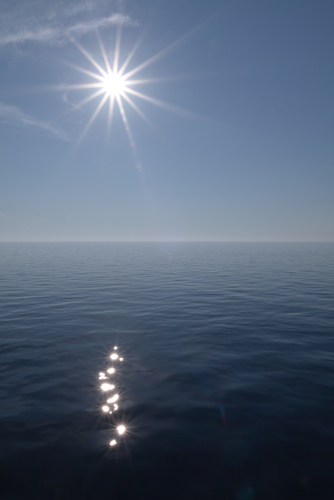 What lies below? The sun and the sea image courtesy of Shutterstock.