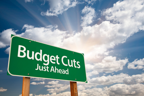 Budget Cuts Green Road Sign image courtesy of Shutterstock