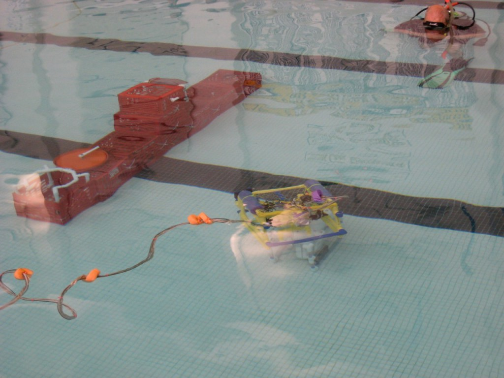 """MATE International Competition 2009.  A student built ROV carrying out a """"rescue mission"""" on a troubled submarine. Photo courtesy of VideoRay / Steve Van Meter."""