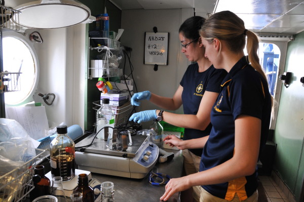 Danielle DeLeo and Dannise Ruiz (two of the authors) making stock solutions of oil and dispersant on board the EV Nautilus during the 2013 field season.